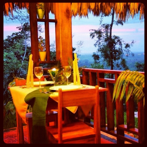 Enjoy dinner while basking in the magnificent sunset and amazing view at Blancaneaux Lodge in the Pine Ridge Mtns of Belize.  1976