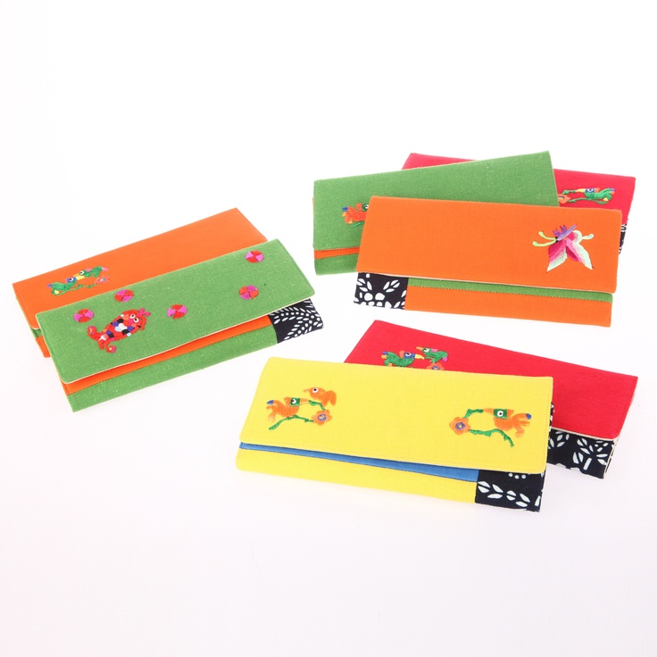 Embroidery handmade linen wallet from Guizhou, China.