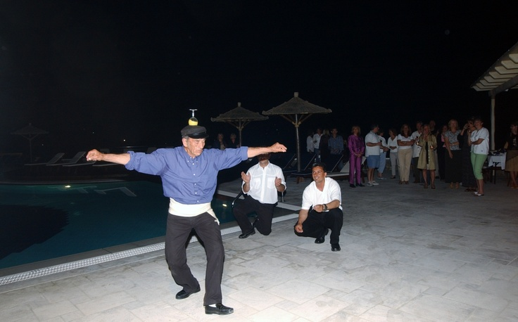 Local dancer dancing at pool area - Mykonos Grand Hotel & Resort