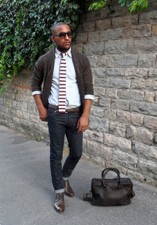 Shop this look on Lookastic: http://lookastic.com/men/looks/tie-and-longsleeve-shirt-and-shawl-cardigan-and-belt-and-derby-shoes-and-jeans-and-briefcase/661 — White and Red Horizontal Striped Tie — Grey Long Sleeve Shirt — Charcoal Shawl Cardigan — Brown Leather Belt — Brown Leather Derby Shoes — Navy Jeans — Black Leather Briefcase