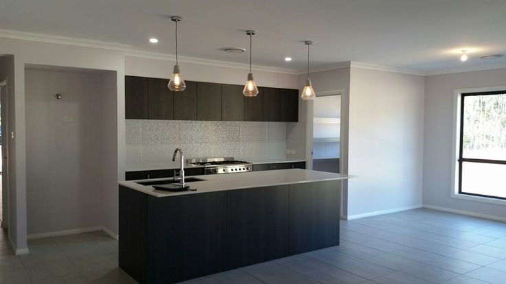 Amazing kitchen. Formica Limed Ash cabinetry. Essa stone benchtop. Backsplash tile from Di Lorenzo