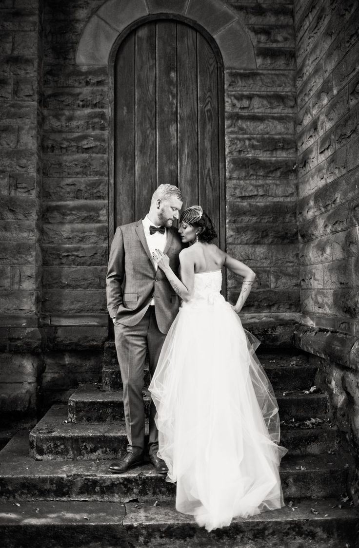 great location for a wedding shoot in front of a rustic building