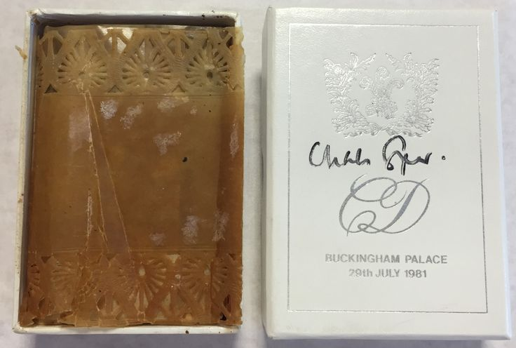 [CHARLES]: (1948-  ) Prince of Wales & [DIANA] (1961-1997) Princess of Wales. A presentation piece of wedding cake from the marriage of Prince Charles and Lady Diana, 29th July 1981. The piece of traditional wedding cake is contained in the original white and silver box printed with the initials of the Royal couple and the Prince of Wales feathers to the lid. The cake is wrapped in the original doyley. Signed by Charles Spencer (1964-  ) Viscount Althorp, brother of Diana, Princess of Wales.