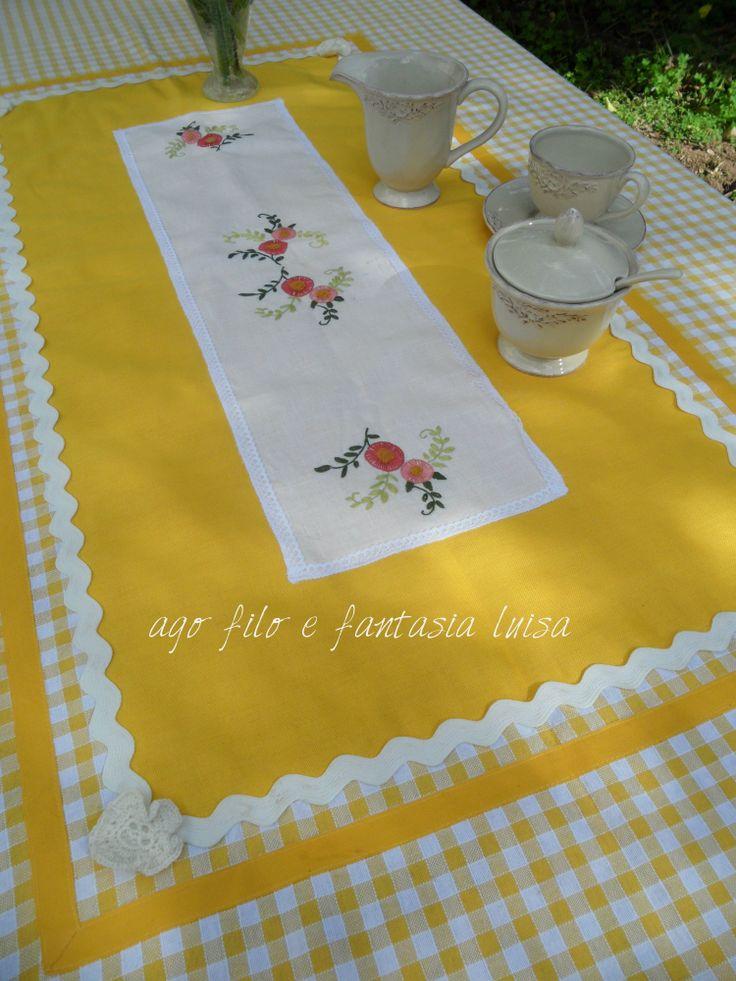 copri tavolo cucito e ricamato a mano