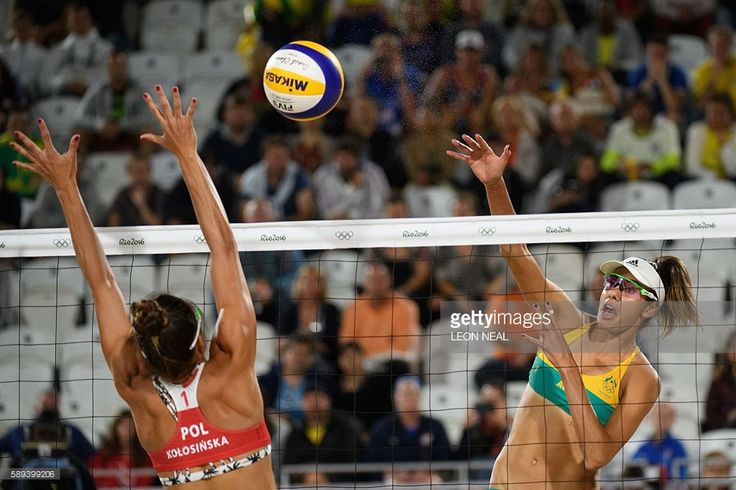 Australia's Taliqua Clancy #1 (R) spikes the ball during the women's beach…