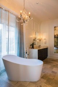 Now that's a tub. Glamorous master bath ensuite designed by @rjohnstoninteriors. Photo by @catnguyenphoto.