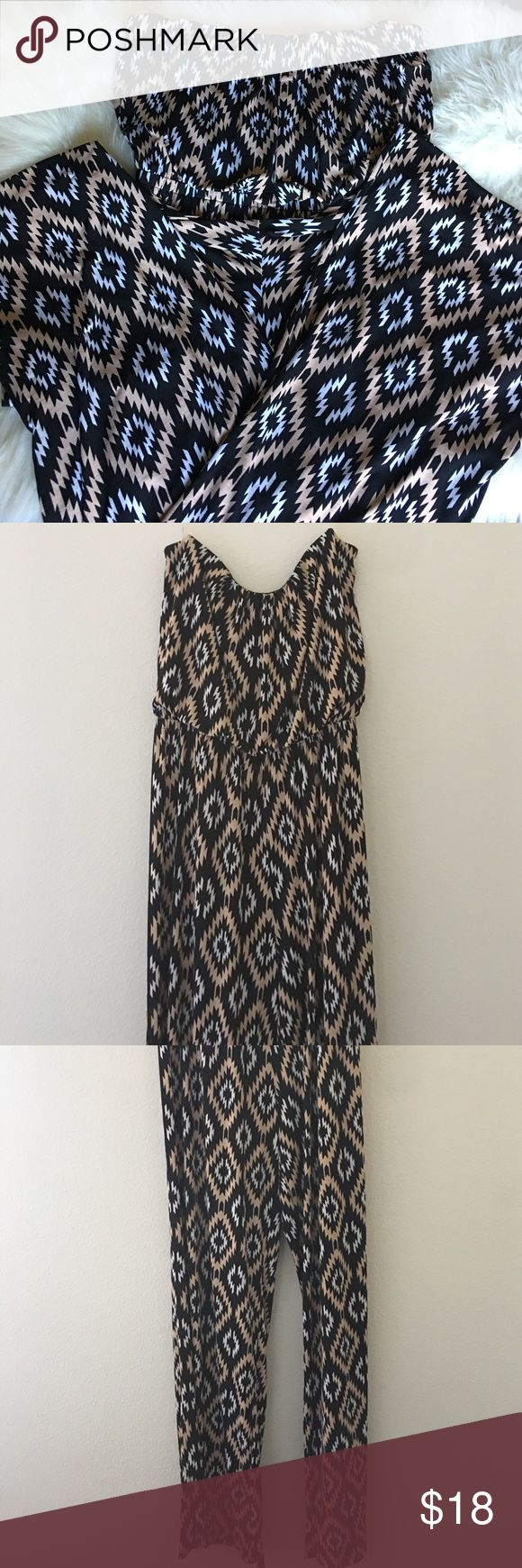 Aztec Jumpsuit Aztec pattern jump suit. Never worn. But when I washed it the first time the letters on the tag came off. It is strapless but stays up very well. This jumpsuit is so adorable but I never find myself having the right occasion to wear it. 😓 Dresses