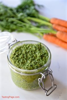 Carrot Top Mint Pesto makes use of your leftover carrot greens for a gluten free and vegan spread, great for topping other vegetables or your favorite protein | TastingPage.com