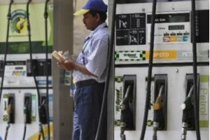 Petrol prices slashed by Rs 3 per litre from Tuesday midnight