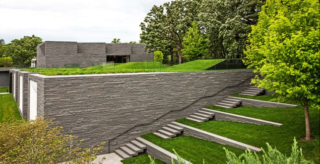 Terraced walls ease the transition between building and landscape and offer opportunities for future memorialization. Lakewood Garden Mausoleum & Lakewood Cemetery.