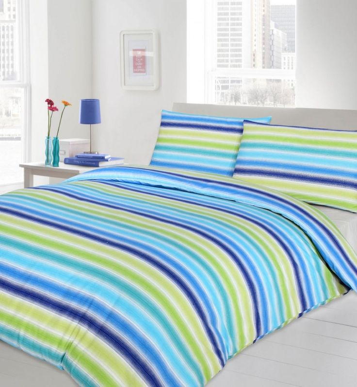 Awesome Lime Green And Blue Bed Sheets In Turquoise Color With Beautiful Flower Pattern In The Glass Vase Also Rectangle Shaped Stripe Pattern Bedding Complete With The Pillows Accessories 23 Chic Bed Sheets Decorating In Turquoise Color Furniture