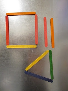 Popsicle sticks with magnets to form structures on oil drip pan