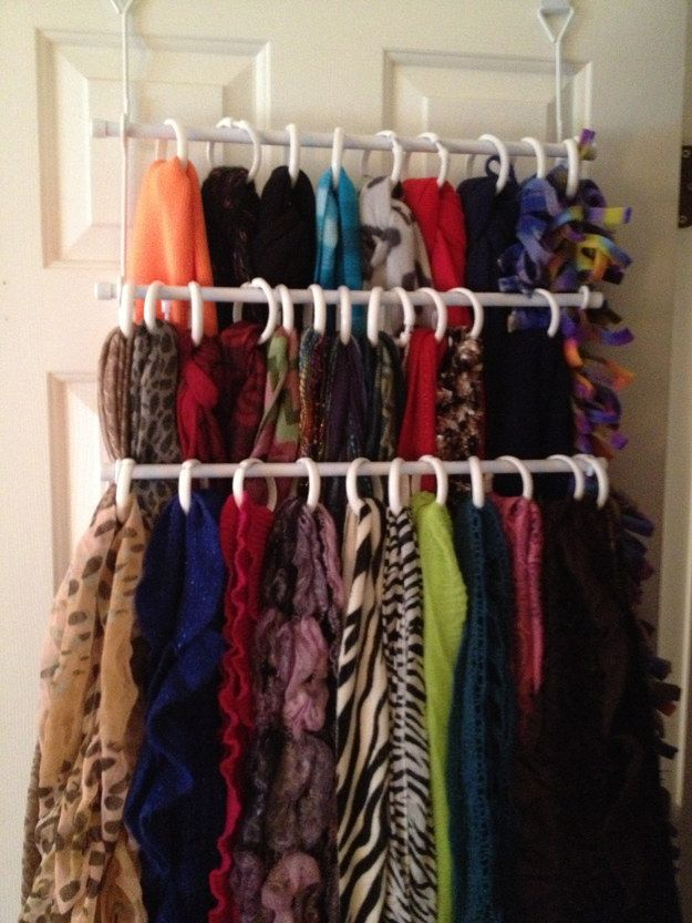 Loop shower curtain rings on an over-the-door towel rack to organize your scarf collection. | 33 Clever Ways To Organize All The Small Things