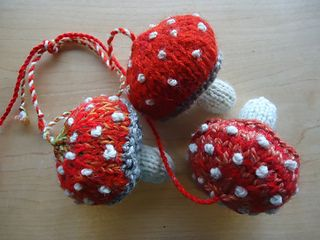 A dozen mushrooms knitted from hand spun and sock yarn stash stuffed with carded wool. Very fun using up little bits combining colors and adding spots. Some spots are french knots, some are duplica...