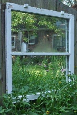 Mirror behind old window frame in garden Trash Pickin' Treasures: A New Window