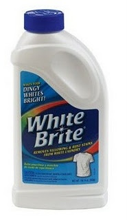 White Brite laundry additive removes yellowing and dinginess (also transferred dye) on white shirts. Can presoak with it or use in washer with regular detergent. Borax and Oxi-clean were also recommended
