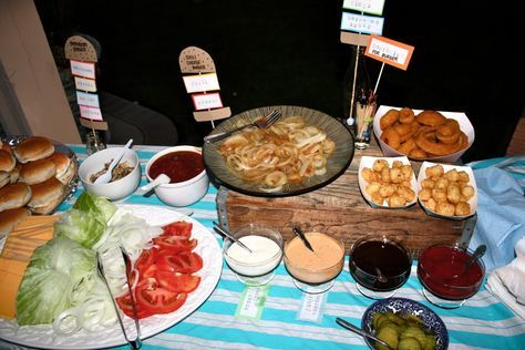 A Backyard Burger Bar... With Plenty of Toppings..great for cookouts!! :)