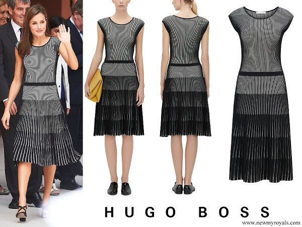 Queen Letizia in HugoBoss 'Franca' a stretch cotton dress.  Crafted with an elaborate two-tone stripe and tiered effect, this dress by BOSS has a fluid silhouette, elasticized waistline and a soft underdress. Queen Letizia of Spain attends the opening of the 2017-2018 scholarship course at 'San Matias' School Centre on September 19, 2017 in Santa Cruz de Tenerife, Spain.