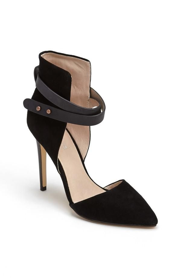 A bold cutout adds a sculptural quality to a strappy pump with slightly padded footbed and a modern set-back heel.
