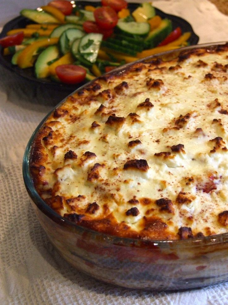 Layers of grilled aubergine, tomato sauce, & soft potato slices with a creamy, cheesy topping make this veggie moussaka a filling, rich & delicious dinner.