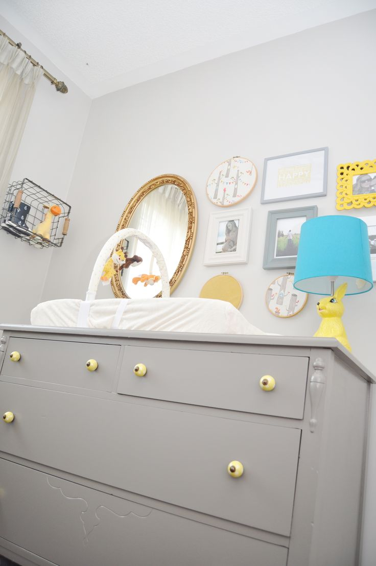 Love the gray dresser with yellow pulls!