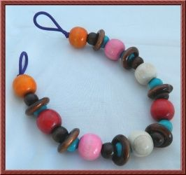 Baby Wood Toy. Stretchy Rattle for Pram, Cot or Pushchair