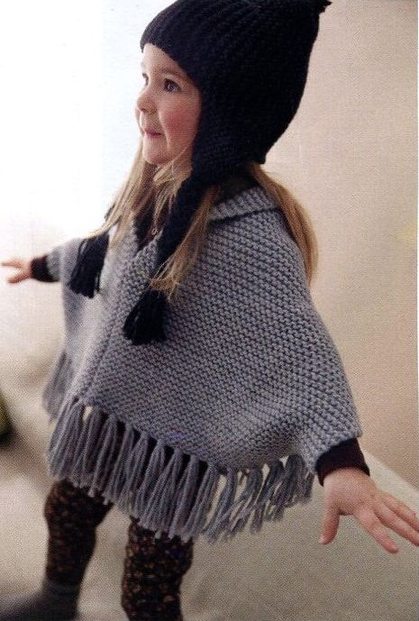 Knitting Pattern for Child's Poncho in Garter Stitch and Hat - Fringed poncho with sleeves in garter stitch with hat are quick knits in bulky yarn. Sizes 2, 4, and 6 years.