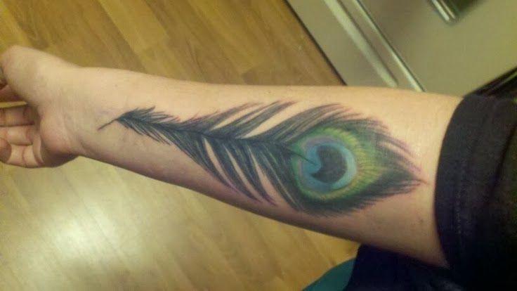 Peacock feather tattoo designs wrist