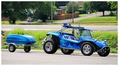 A rare sight in Tennessee, a dune buggy with a surfboard on top. I saw it at the local Dairy Queen. This is a SS Max Dune Buggy body.