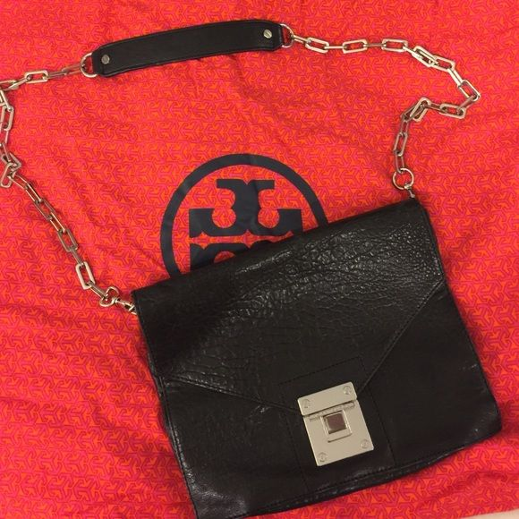 Black Leather Tory Burch Crossbody Handbag Black leather Tory Burch handbag with removable strap to convert into a clutch. Silver hardware. Attached mirror inside with an interior pocket.  Comes with Tory Burch dust bag. Bags Crossbody Bags