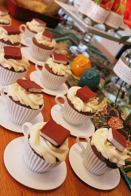 Book cupcakes in teacups. My mom is a librarian and a tea lover so this would be perfect for her birthday and Mother's Day, which always fall in the same week. *Follow my Party Planning board for a method of making the edible dessert books and for more tea party ideas. *