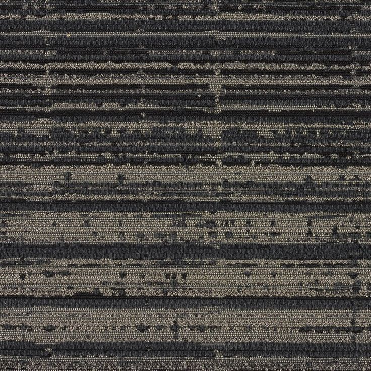 Line Language - Graphite | Line Language is an upholstery fabric reminiscent of the act of drawing and painting. The sophisticated palette of three colors is based on rich art materials such as sumi ink, charcoal and graphite, creating a luxurious textile in look and feel. This linear pattern has a vertical movement of color gradation from both light to dark and thick to thin. Like paint applied with a palette knife, the line work of the pattern shows natural variation, as if created by…