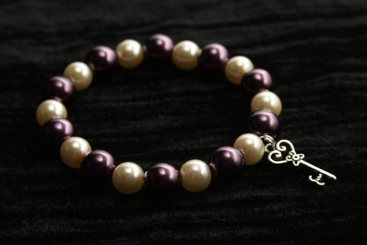 Cream and Burgundy Faux Pearls Bracelet with Silver Key Charm. $15.00, via Etsy.