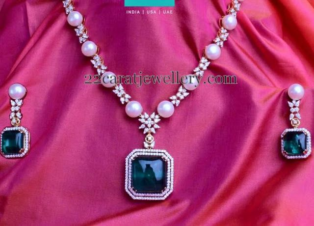 Jewellery Designs: Pearls Set with Green Emerald Dollar