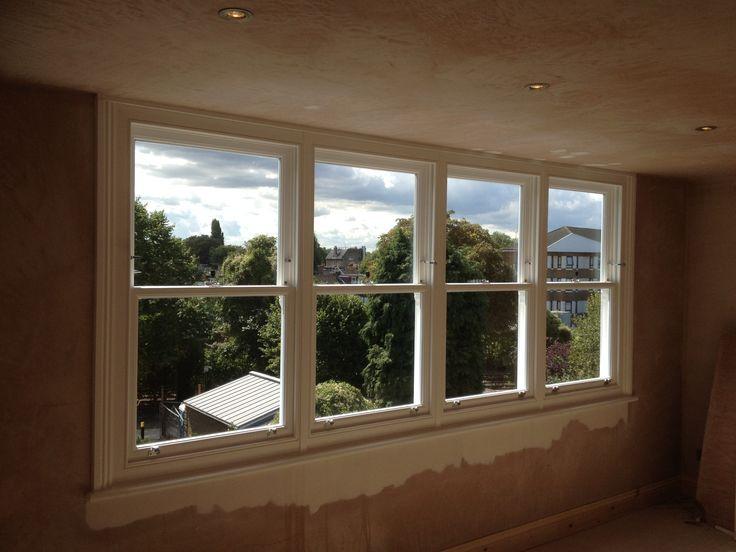 Kew, London. A bank of four uPVC sash windows to a loft conversion.