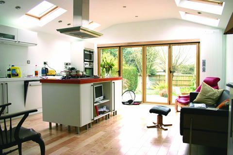Kitchen with side return extension, island and bifold doors