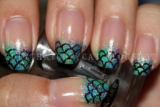 These are awesome. I love the fish-scale design; moreover, her nail beds are simply gorgeous.