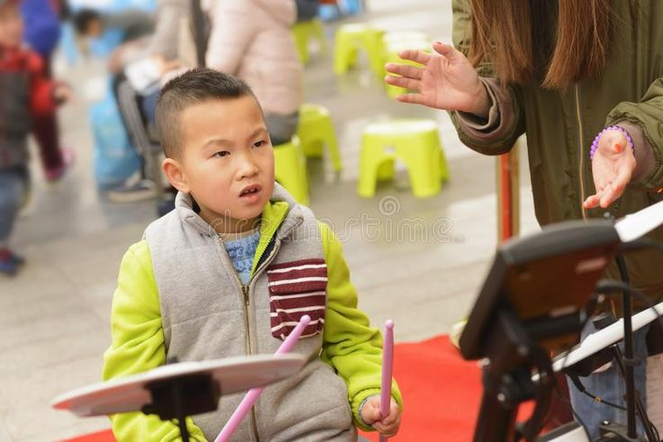 Download Kid Playing Percussion Instrument At Street Stock Image - Image of learn, percussion: 108581193