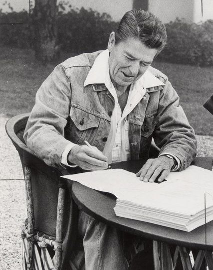 President Ronald Reagan signed a major tax cut in 1981, but his administration soon started looking for new sources of revenue. Credit United Press International
