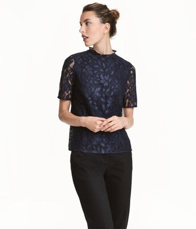 Taupe. Straight-cut lace top with a small stand-up collar, opening with a concealed button at back of neck, and short sleeves. Lined.