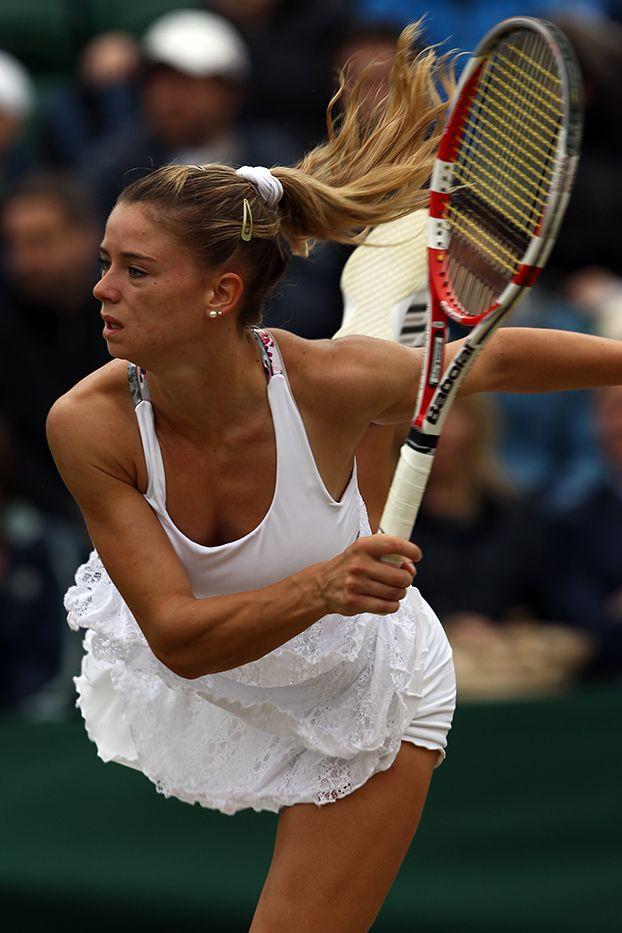 Camila Giorgi serves to Agnieszka Radwanska during their fourth round match. - Steve Wake/AELTC