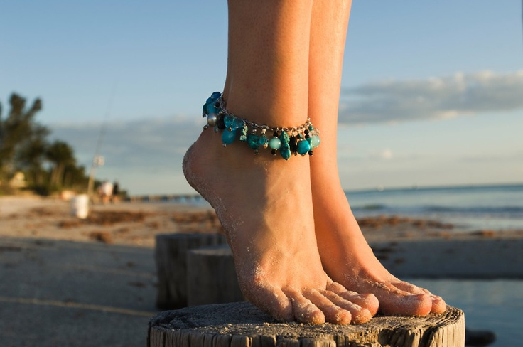 Close up of beautiful feet of a young woman on the piers ...