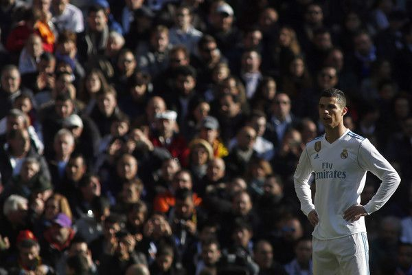 """Real Madrid's Portuguese forward Cristiano Ronaldo reacts during the Spanish League """"Clasico"""" football match Real Madrid CF vs FC Barcelona at the Santiago Bernabeu stadium in Madrid on December 23, 2017.  / AFP PHOTO / OSCAR DEL POZO"""