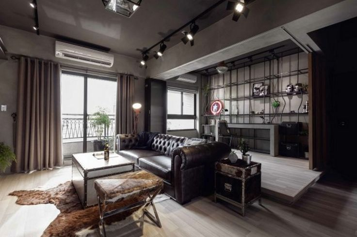 Decoration: Captain America Decor Ideas With Upholstered Leather Sofas In Dark Brown Also Treasure Box Coffee Table And Nightstand On Brown Cow Skin Rugs: Phenomenal Marvel Heroes Themed Home With Concrete Finish