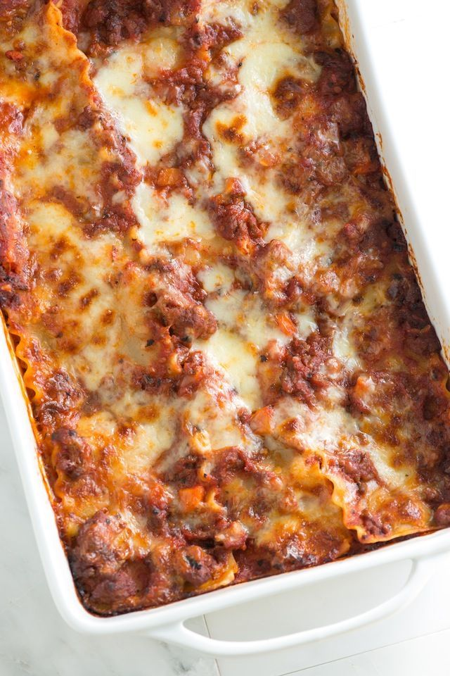 Cheesy Sausage and Beef Lasagna with Ricotta, Parmigiano Reggiano, and Mozzarella. From inspiredtaste.net | @inspiredtaste