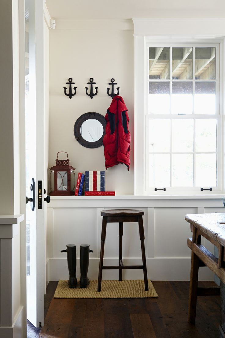 Coastal muskoka living interior design ideas home bunch interior - Muskoka Living Interiors Anchor Hooks Wall Decor Wood Floors Wainscoting Black