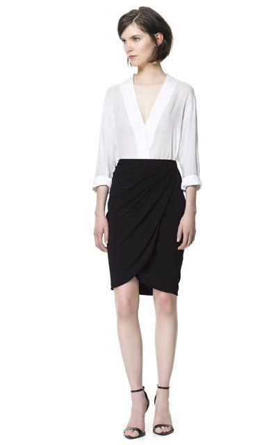 white blouse, sarong black skirt, open heeled sandals
