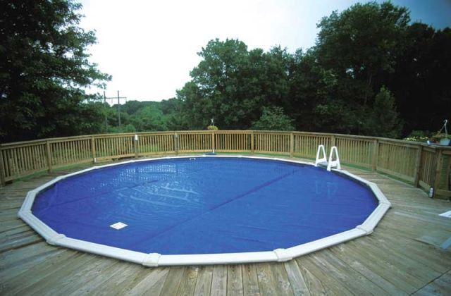 Solar cover above ground pool decks pinterest solar - Covering a swimming pool with decking ...