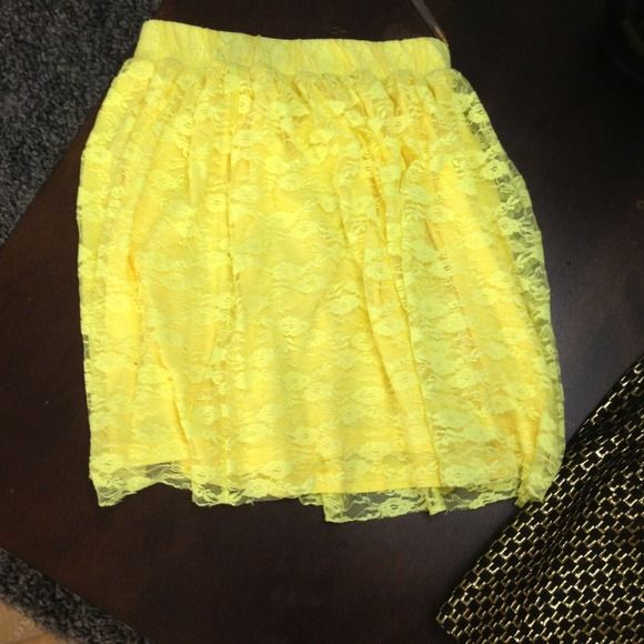 Neon yellow skirt Only worn once, neon yellow mini skirt. Fits at the waist pins and needles Skirts