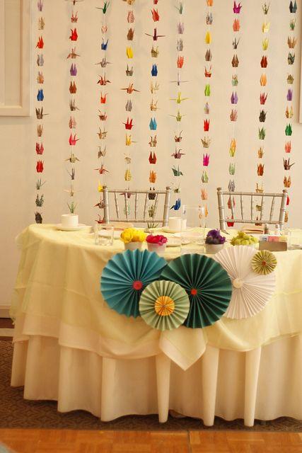 paper crane backdrop & paper rosettes!